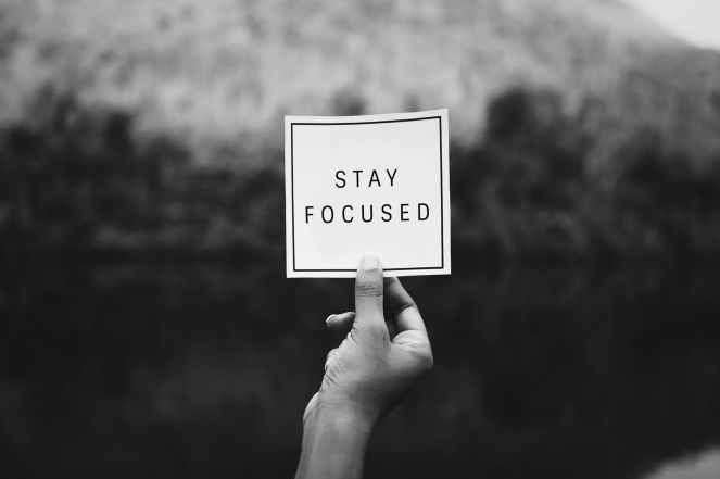 person holding stay focuseds paper